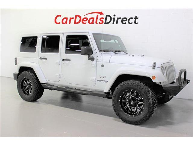 2017 Jeep Wrangler Unlimited Sahara (Stk: 668140) in Vaughan - Image 1 of 28