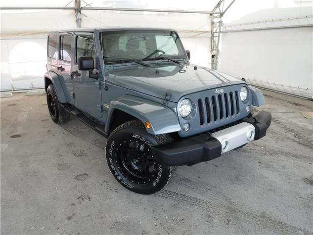 2014 Jeep Wrangler Unlimited Sahara (Stk: ST1654) in Calgary - Image 1 of 21