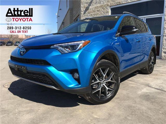 2018 Toyota RAV4 HYBRID SE LEATHER, NAVI, POWER HATCH,SUNROOF, ALLO (Stk: 43693A) in Brampton - Image 1 of 28