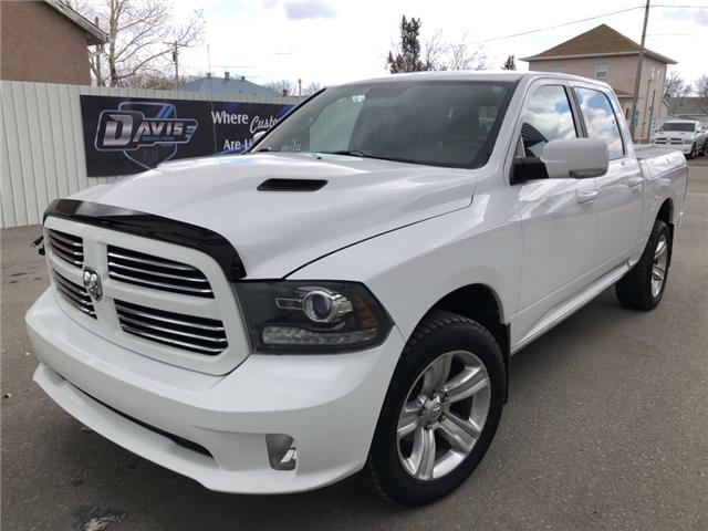 2014 RAM 1500 Sport 1C6RR7MT6ES130278 14676 in Fort Macleod