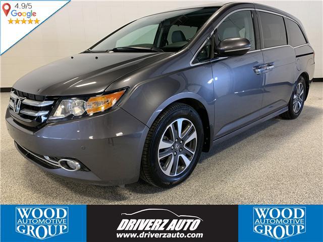 2014 Honda Odyssey Touring (Stk: TR11960) in Calgary - Image 1 of 22