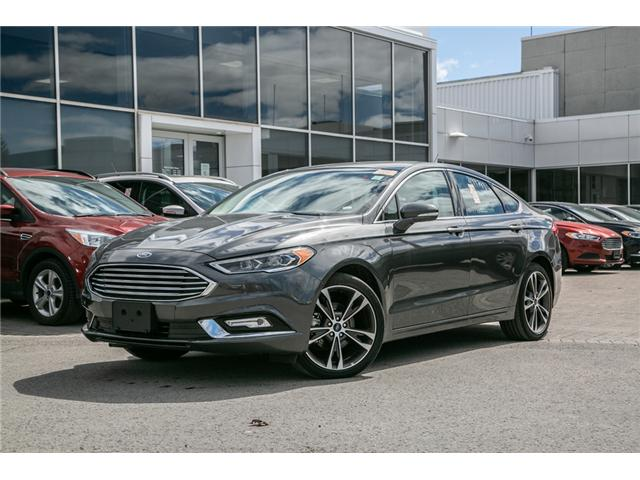 2018 Ford Fusion Hybrid TITANIUM NAV-LEATHER-POWER ROOF-WARRANTY (Stk: 948920) in Ottawa - Image 1 of 28