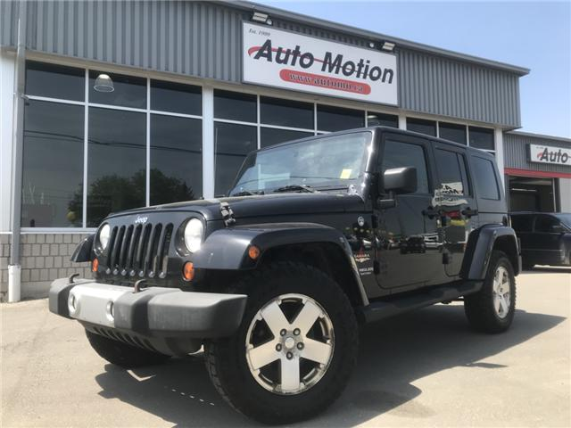 2008 Jeep Wrangler Unlimited Sahara (Stk: 19556) in Chatham - Image 1 of 7