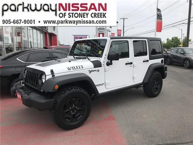 2017 Jeep Wrangler Unlimited Sport (Stk: N19513A) in Hamilton - Image 1 of 12