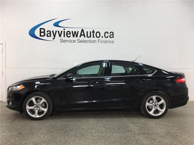2016 Ford Fusion SE (Stk: 35089J) in Belleville - Image 1 of 28