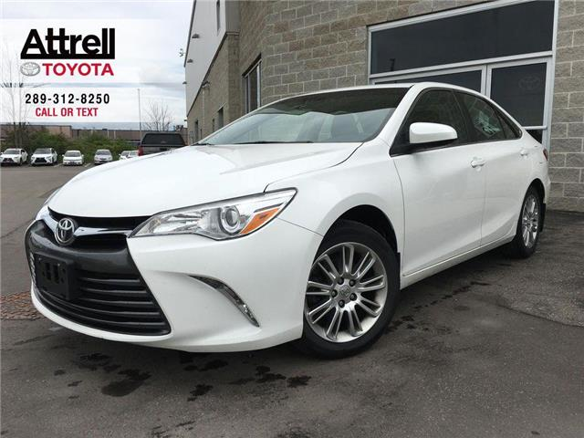 2015 Toyota Camry LE UPGRADE PKG ALLOYS, POWER DRIVER SEAT, BACK CAM (Stk: 8704) in Brampton - Image 1 of 24