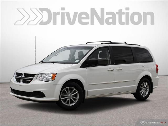 2013 Dodge Grand Caravan SE/SXT (Stk: NE199A) in Calgary - Image 1 of 27