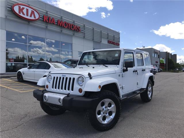 2013 Jeep Wrangler Unlimited Sahara (Stk: 8NR0775A) in Calgary - Image 1 of 18