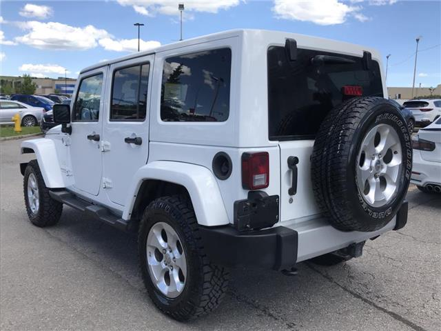 2013 Jeep Wrangler Unlimited Sahara (Stk: 8NR0775A) in Calgary - Image 2 of 18