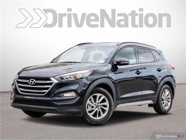 2018 Hyundai Tucson SE 2.0L (Stk: NE229) in Calgary - Image 1 of 27
