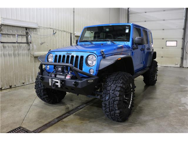 2016 Jeep Wrangler Unlimited Sahara (Stk: JT133A) in Rocky Mountain House - Image 1 of 29