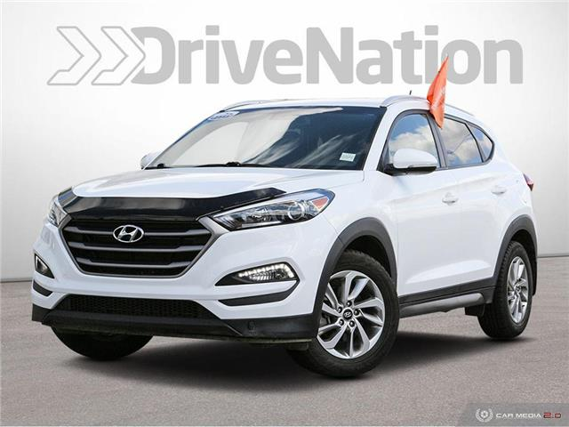 2016 Hyundai Tucson Premium (Stk: NE229A) in Calgary - Image 1 of 27