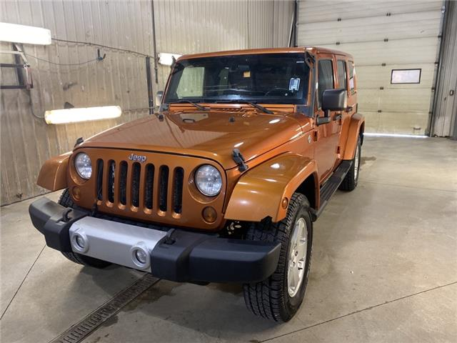 2011 Jeep Wrangler Unlimited Sahara (Stk: LT003A) in Rocky Mountain House - Image 1 of 21