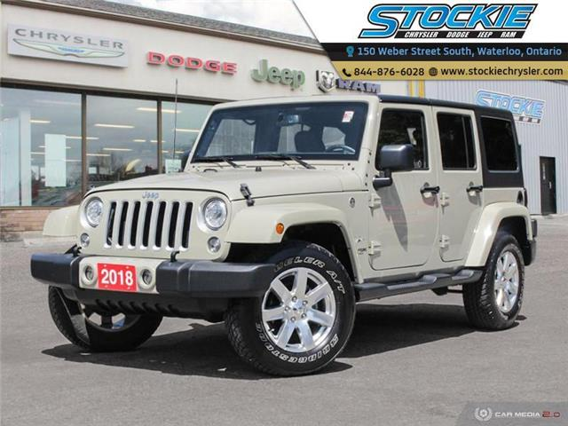 2018 Jeep Wrangler JK Unlimited Sahara (Stk: 34552) in Waterloo - Image 1 of 27
