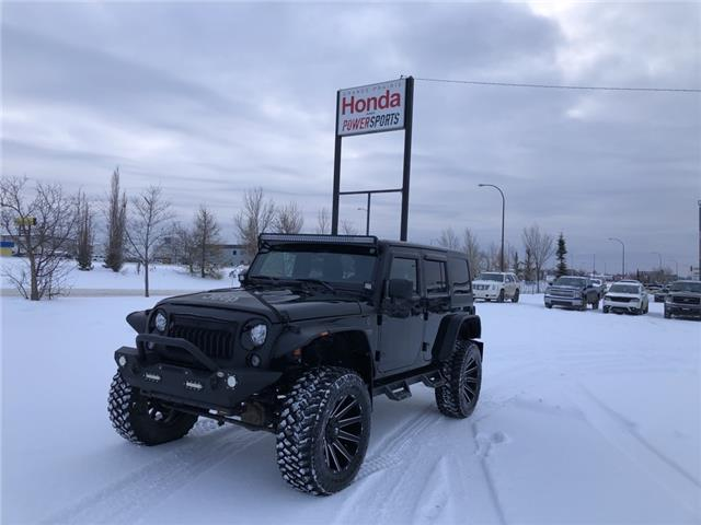 2017 Jeep Wrangler Unlimited Sahara (Stk: P20-055) in Grande Prairie - Image 1 of 22