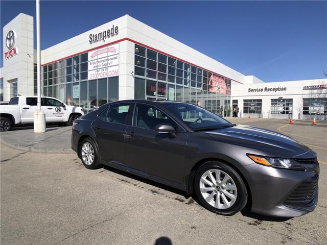 2019 Toyota Camry LE (Stk: 9393A) in Calgary - Image 1 of 21