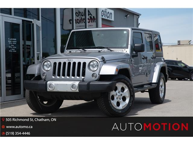 2015 Jeep Wrangler Unlimited Sahara (Stk: 21979) in Chatham - Image 1 of 19