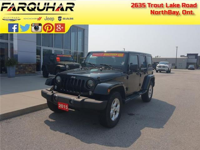 2015 Jeep Wrangler Unlimited Sahara (Stk: 21098A) in North Bay - Image 1 of 30