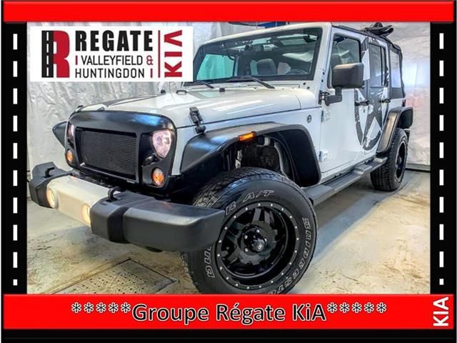 2016 Jeep Wrangler Unlimited Sahara Faites une offre** (Stk: E3822A) in Salaberry-de-Valleyfield - Image 1 of 21