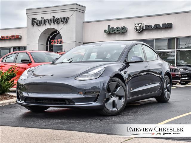 2021 Tesla Model 3 Standard Range Plus (Stk: U18832) in Burlington - Image 1 of 34