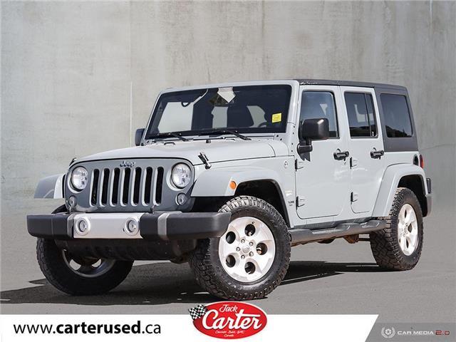 2014 Jeep Wrangler Unlimited Sahara (Stk: 94643U) in Calgary - Image 1 of 24