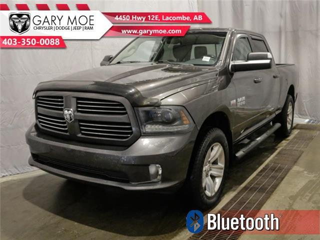 2015 RAM 1500 Sport (Stk: F212693A) in Lacombe - Image 1 of 25