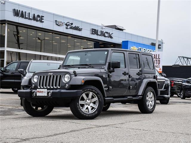 2016 Jeep Wrangler Unlimited 4WD 4dr Sahara, NAV, 2 TOPS, ACCIDENT FREE, LOW KM (Stk: 438561B) in Milton - Image 1 of 24