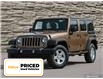 2015 Jeep Wrangler Unlimited Sport (Stk: M2074A) in Welland - Image 1 of 27