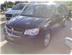 2014 Dodge Grand Caravan SE/SXT (Stk: M0161B) in Shannon - Image 1 of 9
